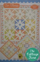 "Star Blooms Quilt Pattern by Fig Tree & Co. This quilt gives you two options, 16"" and 20"" block variations! These star blooms will brighten up the end of bed or an empty wall!    Finished size: 78"" x 78"" with 16"" blocks, 74"" x 74"" with 20"" blocks"