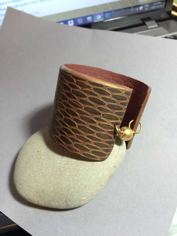 Polymer clay cuff with matte brass magnetic clasp.