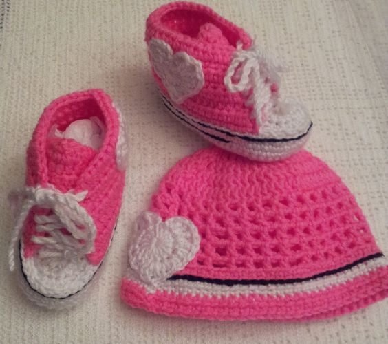 A personal favorite from my Etsy shop https://www.etsy.com/listing/212872420/crochet-pink-converse-booties-and-beanie
