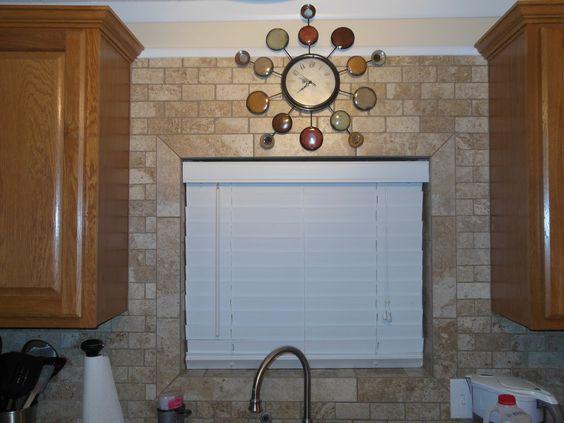 tile backsplash around my kitchen window bull nose border framing the