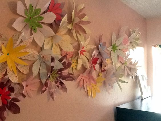 Used extra paper to make large 3-D flowers for wall art. Fold like you would to make a snow flake and cut petal designs. When stapled to the wall they will pop out like a bloom turning toward the sun.for gabbys room