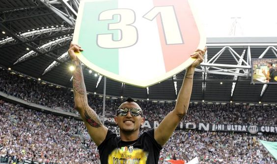 Juventus\ Arturo Vidal holds the Scudetto emblem at the end of the teams Italian Serie A soccer match against Palermo in Turin