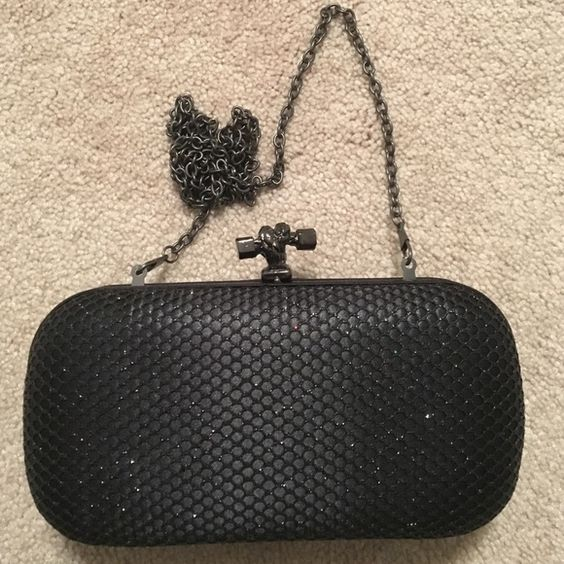 A beautiful shimmery evening bag . It comes with chain . You can use it as clutch or shoulder bag . BCBG Bags Clutches & Wristlets