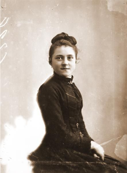 Saint Therese of Lisieux in April 1888, just before she entered Carmel. She was 15. See my board of all things related to St. Therese.