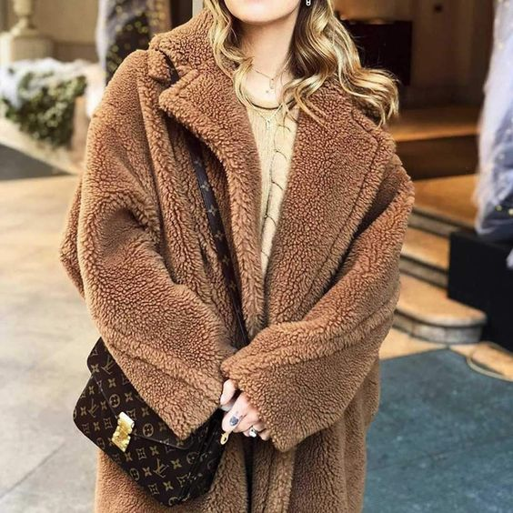 Details: 10% OFF 1st Order Now. Easy Returns & Super Soft. The coziest long teddy faux coat brown fuzzy winter overcoat! This thick fluffy fake fur maxi teddy bear coat is for any body type, and for any chilly cold weather Material: Fluffy soft faux camel Hair and silk-blendColor: BrownSize Details:Size S: Shoulder