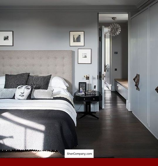 Grey Bedroom With Dark Wood Floors