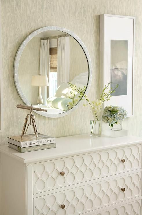 Round White Capiz Mirror Above A White Dresser With Ornate Overlay Trim Accented With Small Round Brass Kno White Dresser White Dresser With Mirror Space Decor