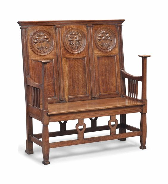 A SMALL ARTS AND CRAFTS OAK SETTLE -  CIRCA 1900.