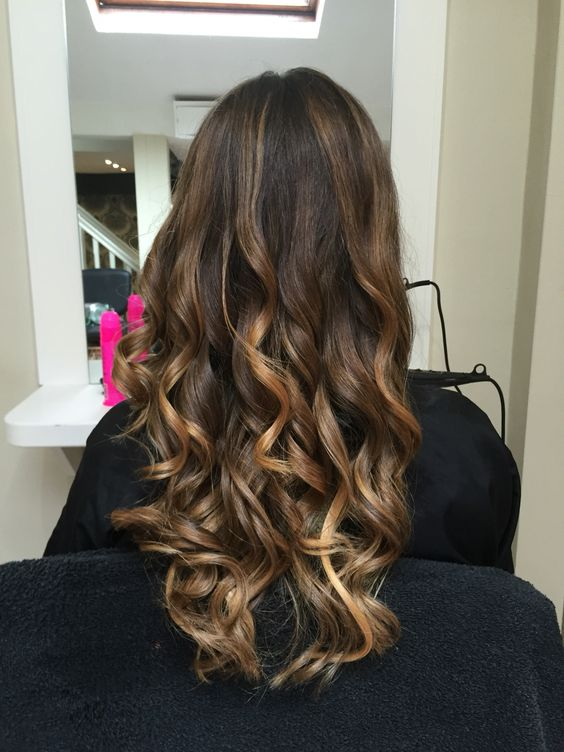 Long brown hair balayage curls hairstyle blonde tones