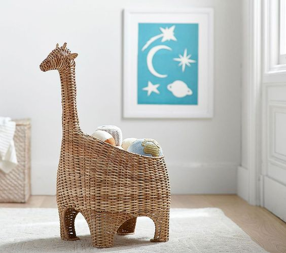 Our wicker basket takes a cue from safari-themed style. Woven from wicker and albaca rope, our basket features giraffe details that your little one will love. Plus, it's great for storing all of their nursery essentials. Pottery Barn Kids partnered with the non-profit organization Nest to ensure that this piece has been ethically handcrafted. DETAILS THAT MATTER Giraffe storage basket is hand woven of wicker and albaca rope over round bar frame. Basket features Giraffe Head, legs and tail. Ethic