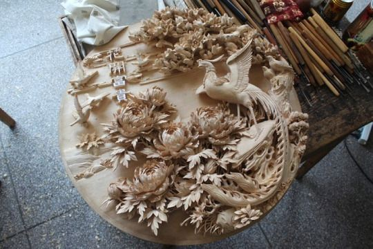 The folk handicraft, Dongyang woodcarving 東陽木雕, is considered one of the major schools of woodcarving in China and was first developed during the Tang dynasty. Named after its place of origin, Dongyang in Zhejiang Province, It is characterized by exquisite high relief carving and delicate design.