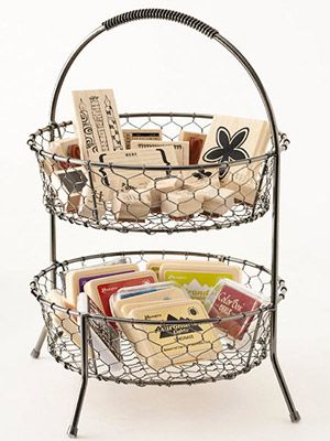 wire baskets for most-used items (tape runner and refills, pop dots, bone folder, scissors, fave stamps and punches, border punches, versamark ink pad, etc)