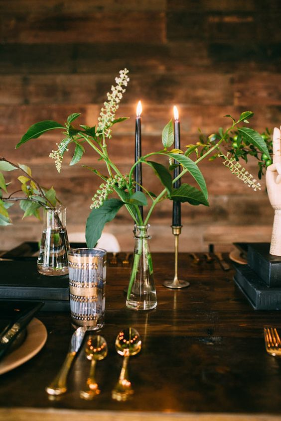 Rustic and glam table scape with gold accents and greens in vases