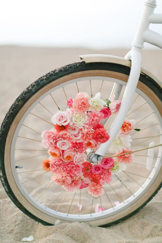 Photography: Ruth Eileen Photography - www.rutheileenphotography.com  Read More: http://www.stylemepretty.com/2014/09/17/diy-floral-beach-cruiser/: