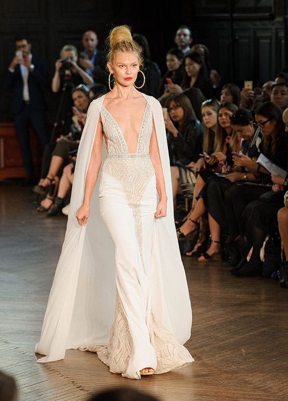 Move over Marvel – Superbride bridal capes are the next biggest thing! Dress by BERTA