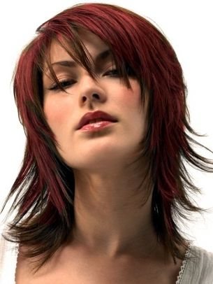 I like the front of this cut, but I would go with an inverted bob towards the back, not a shag - a little TOO close to mullet territory!
