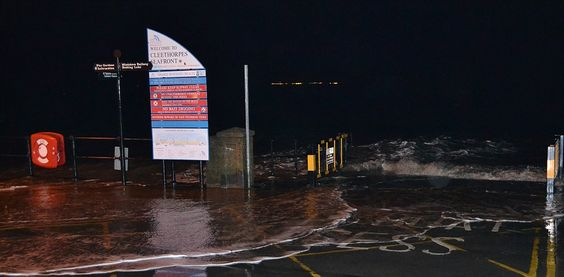 A welcome to Cleethorpes Beach sign sees water underneath it as the River Humber…