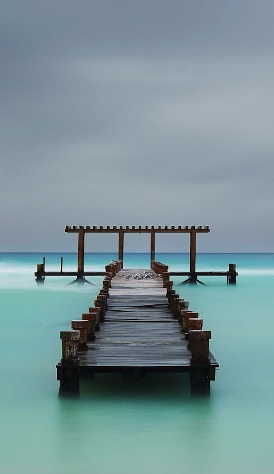 Abandoned pier in Playa Del Carmen, Mexico. Lets go.