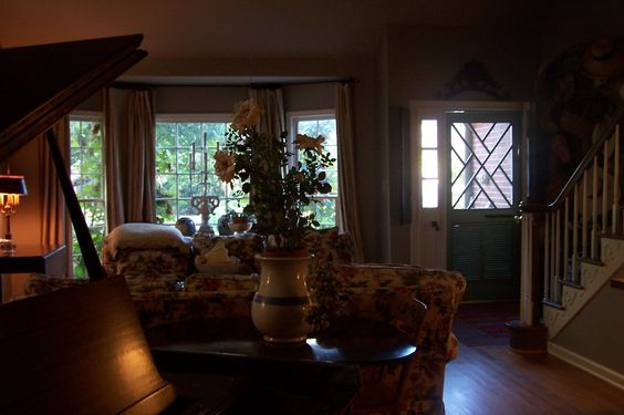 my living room, baby grand, double sofas, card table, chairs, chinoiserie screen door, bay window, wood floors