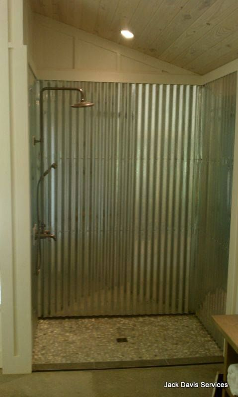 Corrugated tin shower with a river rock shower floor very for Corrugated iron bathroom ideas