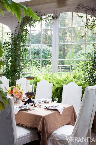 """I just wanted to be outside and grow tomatoes and flowers."" Thirty years on, that simple plot has blossomed into 12 acres that now encompass formal parterres, a conservatory and barn, and a woodland zone meant to blend with the bucolic countryside that surrounds it.  The table is set for lunch in the conservatory, where Williams and her husband, John Rosselli, dine in the summer.   - Veranda.com"