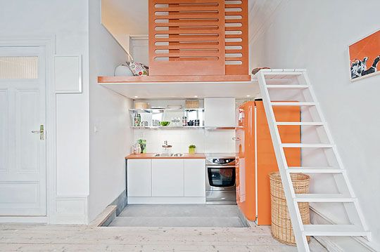 Space efficient kitchen and bed loft