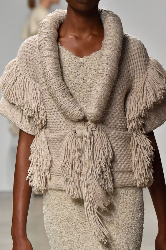 XX couture knit fashion love the wrapped yarn collar line and textural mix of stitches and fringe