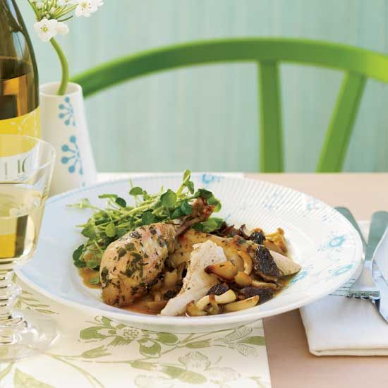 Roasted Herb Chicken with Morels and Watercress Salad | Kevin O'Connor roasts chicken with white wine, whole garlic cloves and plenty of herbs.