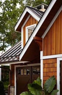 Details. Combination of shakes and board and batten siding with white trim. Metal roof