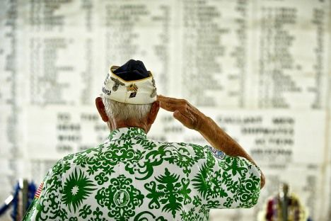 Retired U.S. Army Command Sgt. Maj. Sterling R. Cale, a 90-year-old Pearl Harbor survivor, salutes the 1,177 service members who lost their lives during the attack on the USS Arizona Dec. 7, 1941. (Photo courtesy of the Dept. of Defense.)