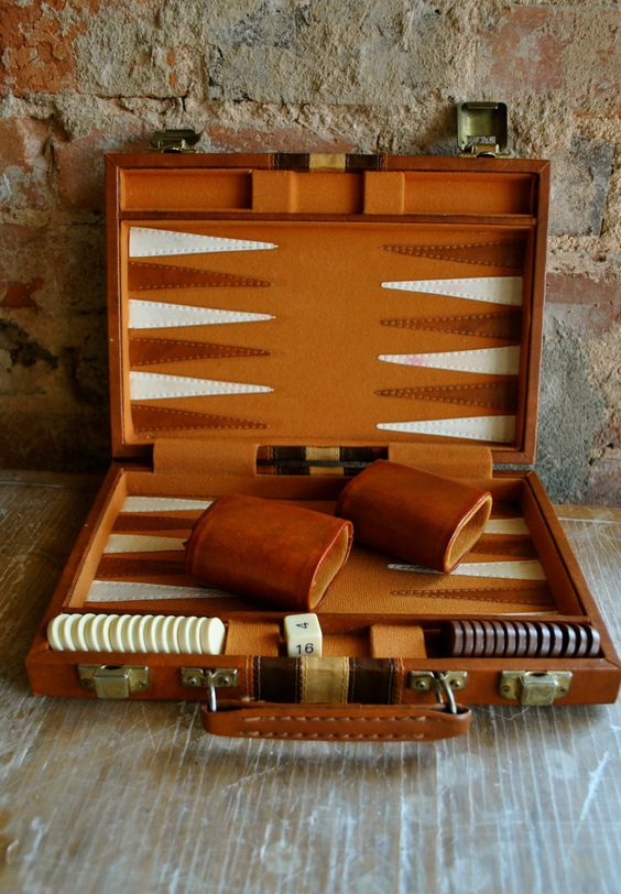 Backgammon always reminds me of my one grandma. When I would go over to her apt when I was little my relatives would play this.: