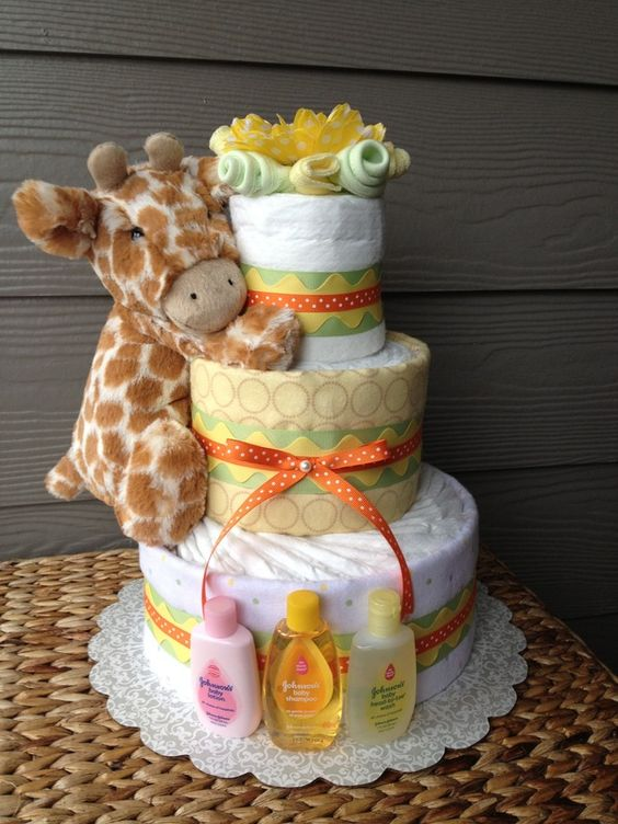 Diaper & Towel Cakes- I like this better than just a diaper cake: