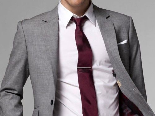 The deep red tie is great, but what really completes this look is the VERY soft pink shirt underneath. And the pocket square and tie clip, of course.