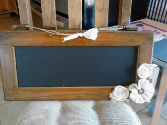 Cute Idea: old cabinet door, paint with chalkboard paint, hang from hinges with twine.