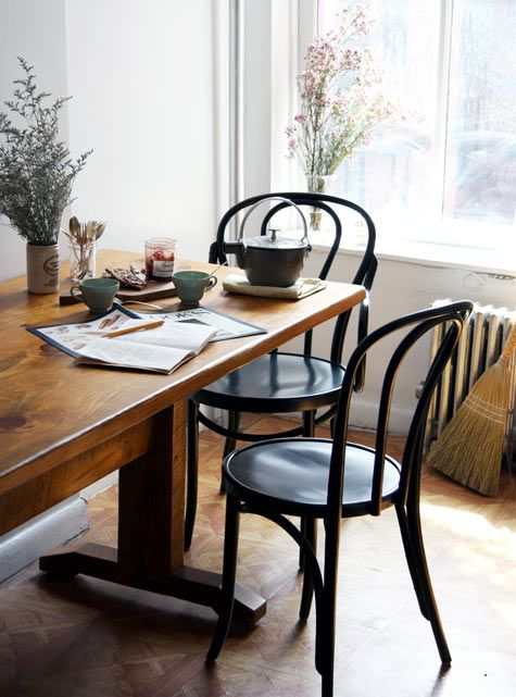 black cafe chairs, trestle table: