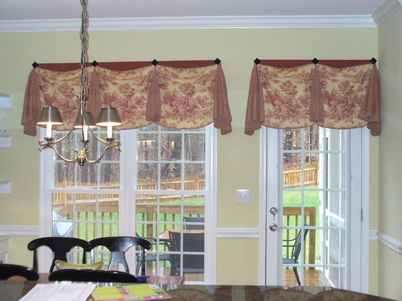 this valance over the french door was done very cleverly... see next photo  for the way the mounted it to allow the door to open, yet keep the valan