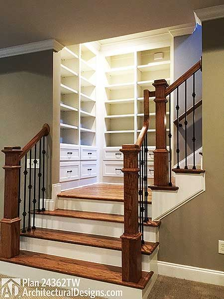Built-ins at the stair landing in 4 Bed House Plan 24362TW ~2,800 sq. ft. with walkout basement Architectural Designs, #readywhenyouare