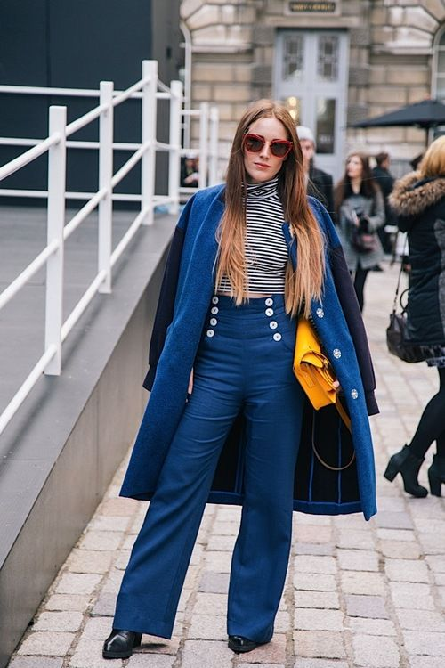 Oh la la! We want those buttoned up trousers and the stripey turtle neck.