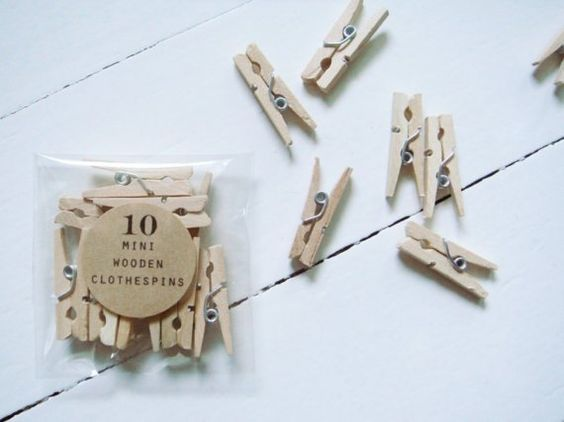 mini clothespins. got mine at fred meyer for $2.00 and i love them.