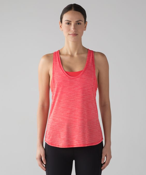 We designed this 2-in-1 tank  with mesh paneling in the bra  to keep air flowing during  sweaty training sessions.
