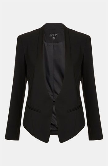 Like women wearing this kind of angled blazer by Topshop