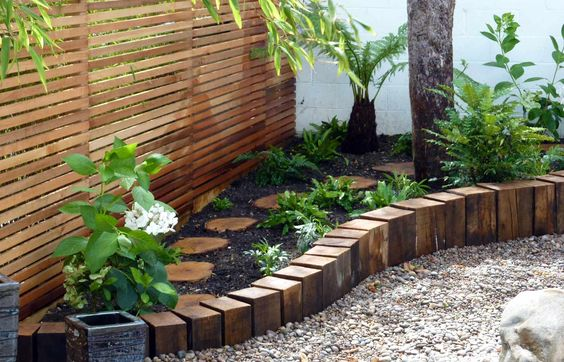 Wooden stepping stones amongst the plants