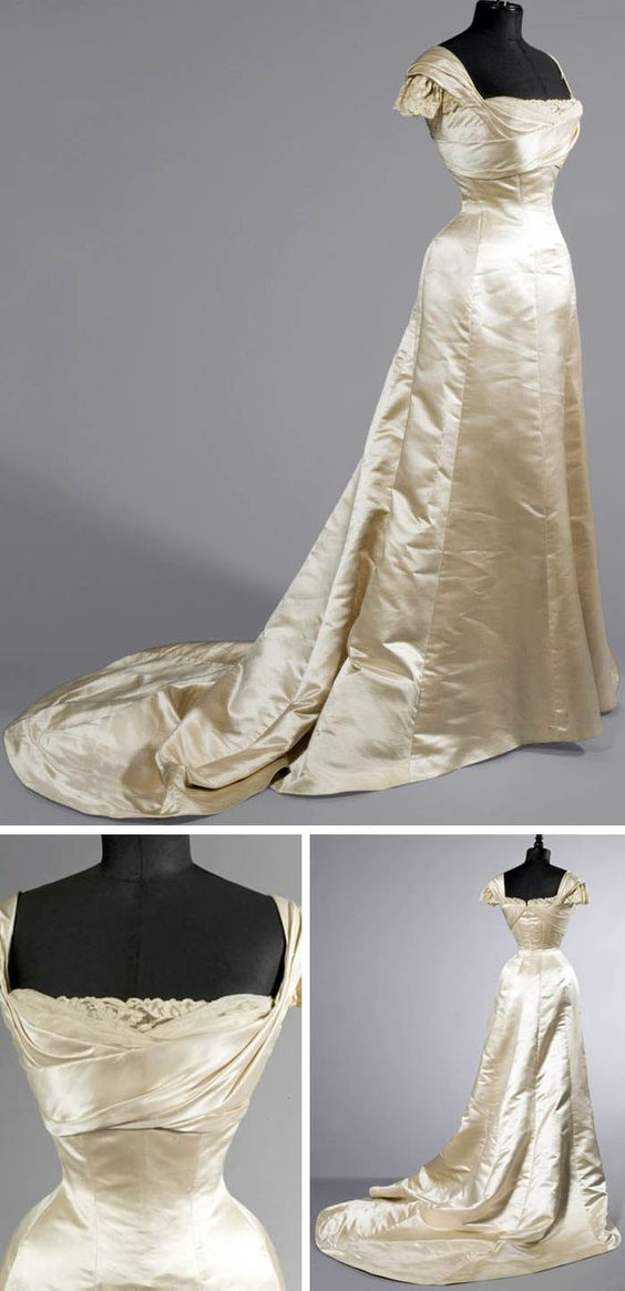 Ball Gown, c.1900. Maison WORTH, Champagne-colored Duchesse satin with tulle and machine lace. Butterfly sleeves, boned bodice. Auction House:Artcurial .....LOOK at what the estimated auction price was and LOOK at the realized price! Estimation 1 000 - 1 500 € Sold for 21,270 € -