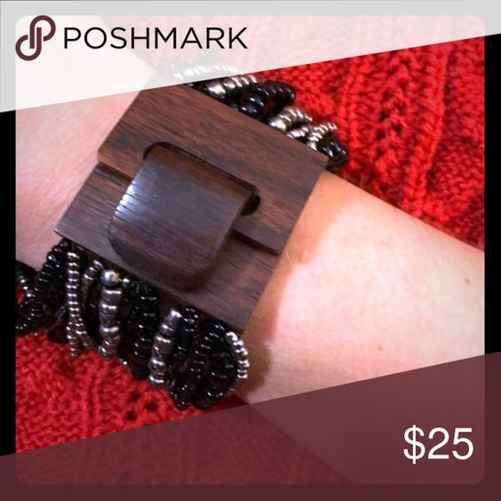 Multi strand beaded bracelet with wood closure Multi strand beaded bracelet with wooden closure Jewelry Bracelets