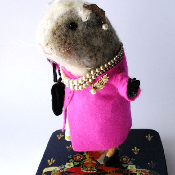An Original Needle felted Animal Pink Queen, Elizabeth my Dear.  Designed and made by Miss Bumbles. Elizabeth has wire in her legs, arms and hands, and black glass beads for eyes.   Ah Elizabeth has another birthday, well she has two this year, indeed she has two every year when one is the Queen one can have two Birthdays if one wishes it means lots of prezzies, cards and ...Cake! Elizabeth is out on a meet and greet , shes done quite a lot of that over the years, she favors bright colours…