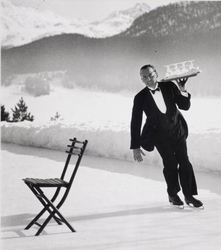 Alfred Eisenstaedt, Headwaiter Renée Breguet of Grand Hotel St. Moritz serving cocktails on ice rink, 1932: