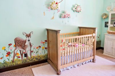 This baby girl's vintage mountain meadow nursery theme includes an original mural featuring a whitetail deer fawn and flowers painted by her...