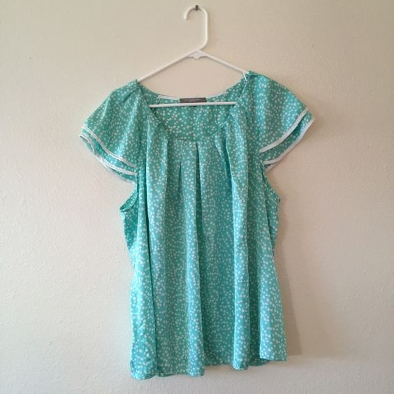 NWOT Mint Polka Dot Top Loose fitting and flowy. 100% polyester.  ***Clothes may be wrinkly in photos due to being folded and stored in totes. Clothes are from a smoke free home. I may be up for trades if your items are sized 1X and up and shoe size 8.5. If you need measurements or just have questions about an item just ask! Orders will be shipped within 3 days.*** NY Collection Tops Blouses