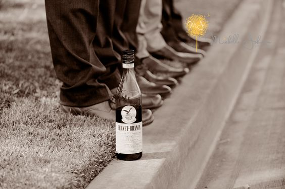 Wine bottle and groomsmen