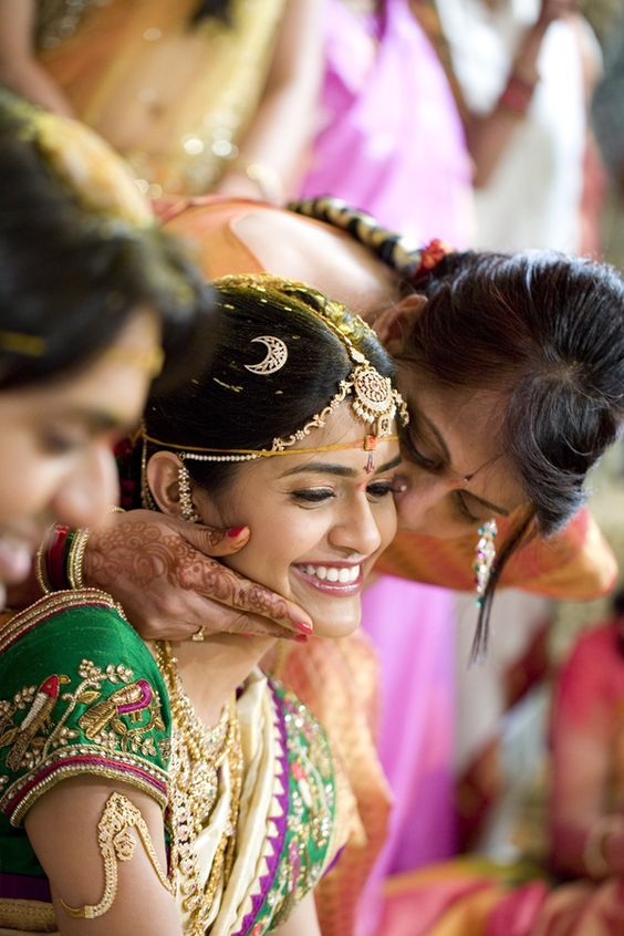 Mandapmoments capturing Bride and her Mom like this | South Indian Mandap Shots | Bridal Jewellery | Mother Blessing her daughter | Bride and Mom moments captured candidly | Mom and Bride Picture Ideas | Cute Bride and Mother Photo Ideas | Indian Wedding | Indian Brides | Function Mania | You Have to See These Picture-Perfect Mother & Bride Moments!